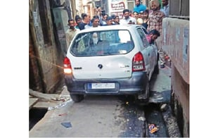 The accused's car stuck in a lane in Jandiala in Amritsar on Sunday.