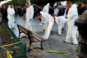 Forensic experts work near the site of an explosion in the centre of the Tunisian capital Tunis, Tunisia on October 29, 2018.