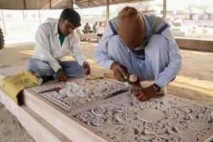 A stone's throw away from Karsevakpuram is a workshop where volunteers and workers toil away for hours chiseling massive slabs of stone and wood into ready-to-move building blocks for the temple — a project that has been going on for more than a decade.