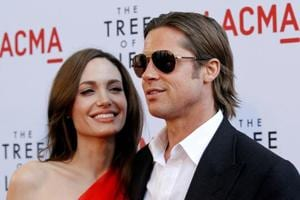 Brad Pitt and actor Angelina Jolie pose at the premiere of The Tree of Life at LACMA in Los Angeles.