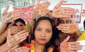Sixteen protesting women teachers in Patiala got 'Punjab Sarkar Murdabad' written on their hands with 'heena' on the occasion of 'Karwa Chauth' as their protest for regularisation of their jobs without a pay cut entered its 21st day on Saturday.