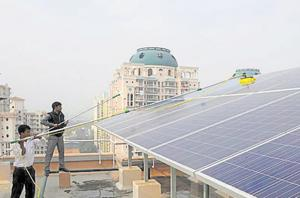 A rooftop-installed solar power plant on a Gurugram highrise.