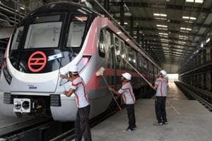 Workers clean a train at Vinod Nagar yard after its trial run  between Trilokpuri- Shiv Vihar  section on Delhi Metro's Pink Line, Monday, October 29, 2018.