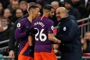 Manchester City players celebrate withmanager Pep Guardiola on Monday.