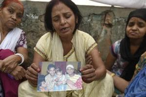 Family members of Sushil who, along with two other men, was killed after being run over by a train in outer Delhi