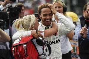 Lewis Hamilton (right) celebrates after winning his fifth drivers