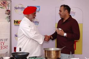Former cricketer Virender Sehwag with Chef Manjit Singh Gill at the HT City Culinary Fest.