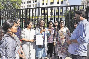 Parents gather outside Vibgyor school, NIBM, to protest against the fee hike on Tuesday.
