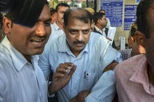 Deputy Superintendent of Police Devender Kumar after being produced at Patiala House Courts in New Delhi.