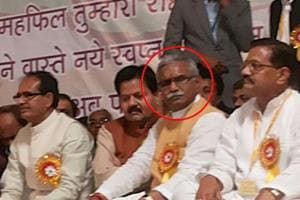 Gulab Singh Kirar (in circle), an accused in the Vyapam scam, sharing dais with chief minister Shivraj Singh Chouhan during a function in Raisen district on February 3,2015.  Kirar joined the Congress on October 31, 2018 but the party later denied he was extended its membership and deleted the tweet announcing it.