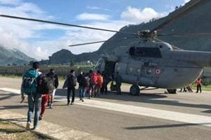 Pilgrims boarding a helicopter at Naini Saini airport in Pithoragarh. The DGCA has given conditional approval for flying a 9-seater aircraft from the airport before Diwali.