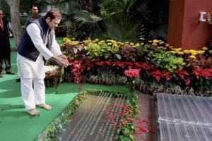 Congress president Rahul Gandhi pays homage to former prime minister Indira Gandhi on her death anniversary, at Indira Gandhi Memorial in New Delhi on Wednesday, October 31, 2018.