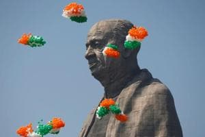 """Indian tri-coloured balloons fly around the """"Statue of Unity"""" portraying Sardar Vallabhbhai Patel during its inauguration in Kevadia, in Gujarat on October 31."""