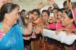Rajasthan Chief Minister Vasundhara Raje interacts with women in a public rally during her