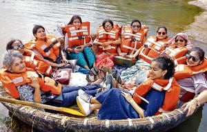 Radhika Naware (third from left), founder of Treasured Holidays, a niche travel company that offers designer craft and textile trails across India, with her clients on a coracle (a boat made of wickerwork, propelled with a paddle) ride, in Hampi during one of the trails.