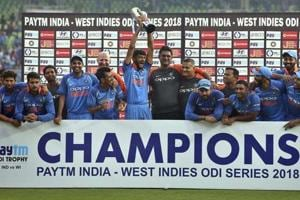 Khaleel Ahmed lifts the trophy after India beat Windies 3-1 in the series.