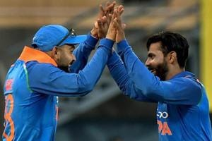 Guwahati: Indian cricket team Captain Virat Kohli celebrates with teammate Ravindra Jadeja during the first One Day International cricket match against West Indies.