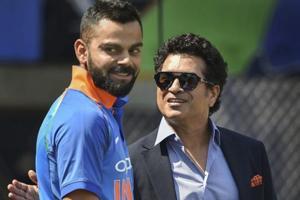 Virat Kohli and Sachin Tendulkar before the 4th ODI cricket match between India and West Indies at Brabourne Stadium.