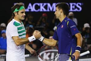 File Photo: Novak Djokovic of Serbia (R) shakes hands after winning in his semi final match against Roger Federer of Switzerland.