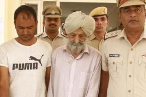 Prime accused  Harnek Singh Dhillon (right)  was arrested on October 24 after he allegedly confessed to killing his wife,to cover up the murder of a flour mill owner. His aide, Jagdish Kumar (in t-shirt) will be taken to Punjab by Gurugram police to locate the missing body parts of the mill owner.