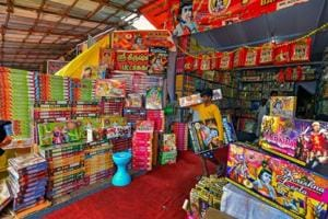 Retailers arrange crackers in their shop for sale ahead of Diwali festival celebrations, in Chennai.