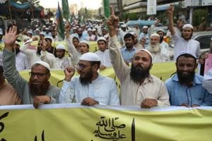 Pakistani activists of the Islamic Jamiat-e-Ittihad ul Ulema party chant slogans during a protest following the Supreme Court