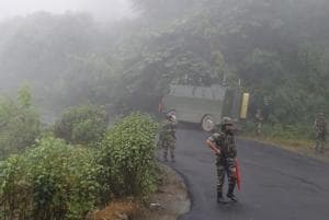 Soldiers guard a road stretch between Imphal and Moreh, a town located on the India-Myanmar border.