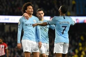 Leroy Sane (L) celebrates with midfielder Phil Foden (C) and midfielder Raheem Sterling (R) after scoring their sixth goal.
