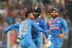 Indian cricketer Krunal Pandya (L) celebrates with teammates after taking the wicket of West Indies cricketer Kieron Pollard during the first T20 cricket match between India and West Indies at the Eden Gardens.