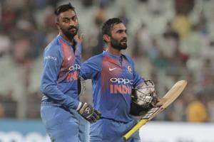 Krunal Pandya (left) and Dinesh Karthik walk back after winning India the openingT20I at the EdenGardens.