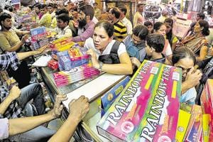 People buy the fire crackers at Essabhai Fire Works for Diwali festival at Masjid Bunder