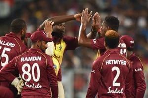 Kolkata: West Indies bowler Oshane Thomas celebrates with teammates after taking a wicket.