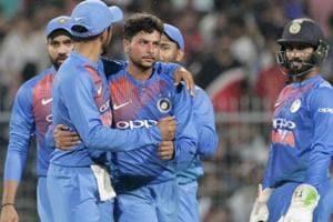 Kuldeep Yadav celebrates with teammates the dismissal of West Indies