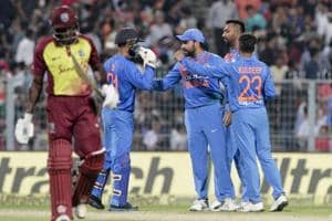 Indian players celebrate the fall of a Windies wicket at the Eden Gardens onSunday.