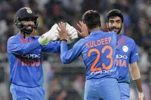 Kuldeep Yadav (23) celebrates the fall of a West Indies wicket.
