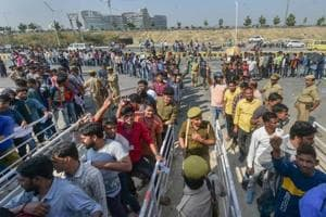 Cricket fans queue up to buy tickets for the forthcoming T20I match between India and West Indies at Ekana Stadium in Lucknow.