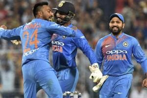 Krunal Pandey celebrates the wicket of West Indies batsman Kieran Pollard.