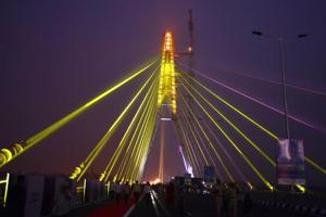 A view of the Signature bridge during the laser show after its inauguration in New Delhi, India, on Sunday, November 4, 2018.