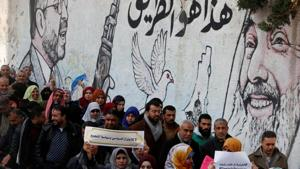 Palestinians protest against the US decision to cut the $200 million aid to Palestine, which will likely result in many in Gaza and West Bank losing their jobs
