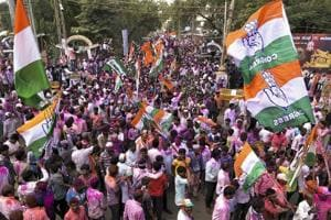 Congress workers celebrate after the party's win in Jamakhandi assembly bypoll, on Tuesday.