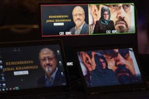 Hatice Cengiz, the fiancee of the late Washington Post journalist Jamal Khashoggi, delivers a prerecorded message (upper R) during a remembrance ceremony for her fiancée in Washington, DC on November 2.