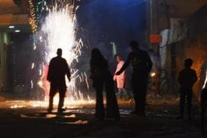 People burst crackers on Diwali at Saket.