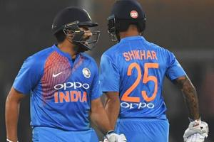 Rohit Sharma (L) and cricketer Shikhar Dhawan (R) walk during the second T20 cricket match between India and West Indies.