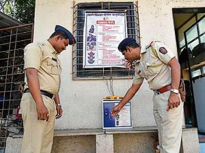 Police officials checking a complaint box at Sindhu park society in Pimple Saudagar in Pune on Wednesday.
