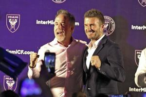 Jorge Mas (left) and David Beckham celebrate in Coral Gables after Miami voters gave city officials permission to negotiate a no-bid lease deal with Beckham