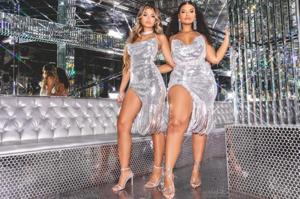 Pretty Little Thing's latest campaign features two models of different sizes standing alongside one another, wearing the same silver bodycon dress.