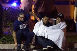 A 28-year-old former Marine opened fire in a California country music bar packed with college students, killing 12 people including a police officer as dozens of terrified youngsters stampeded towards the door, authorities said Thursday.