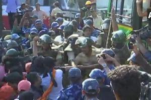 Police detain several people protesting against Tipu Sultan Jayanti celebrations in Madikeri on Saturday.