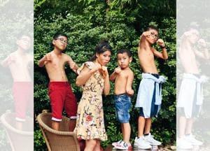 Mary Kom bonding with her kids Rengpa, Prince and Nainai.  Location courtesy: Taj Mahal Hotel, New Delhi; Art direction: Amit Malik; Make-up and hair: Artistry by Anjali Jain. On Mary: Dress, Forever New. On Rengpa (left): Shirt and shorts,UCB; shoes, Nike. On Prince (centre): T-shirt and shorts, UCB; shoes bought from Vietnam. On Nainai (right): Shirt, UCB; shorts, Zara Kids; shoes, Nike