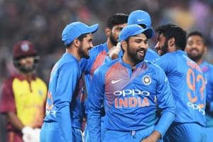 Indian T20 cricket captain Rohit Sharma (C) celebrates with teammates the wicket of West Indies cricketer Shai Hope during the first T20 cricket match between India and West Indies